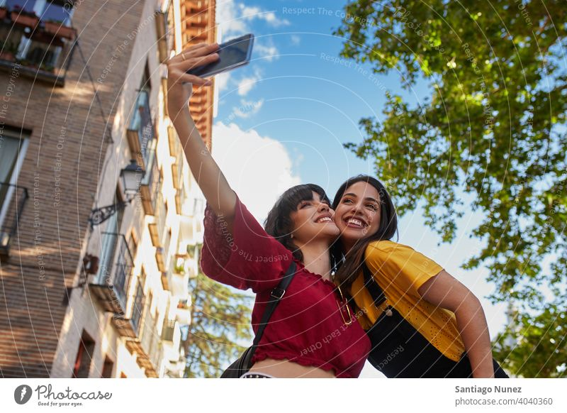 Two teenager girls taking a selfie. madrid young people friendship lifestyle beautiful fun happy together leisure woman smiling teens cheerful female youth