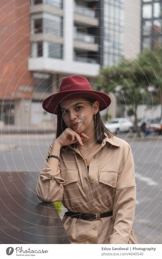 Young girl enjoying a nice afternoon in the city. casual attire drinking beautiful woman hot drink cup female portrait caucasian attractive computer smile