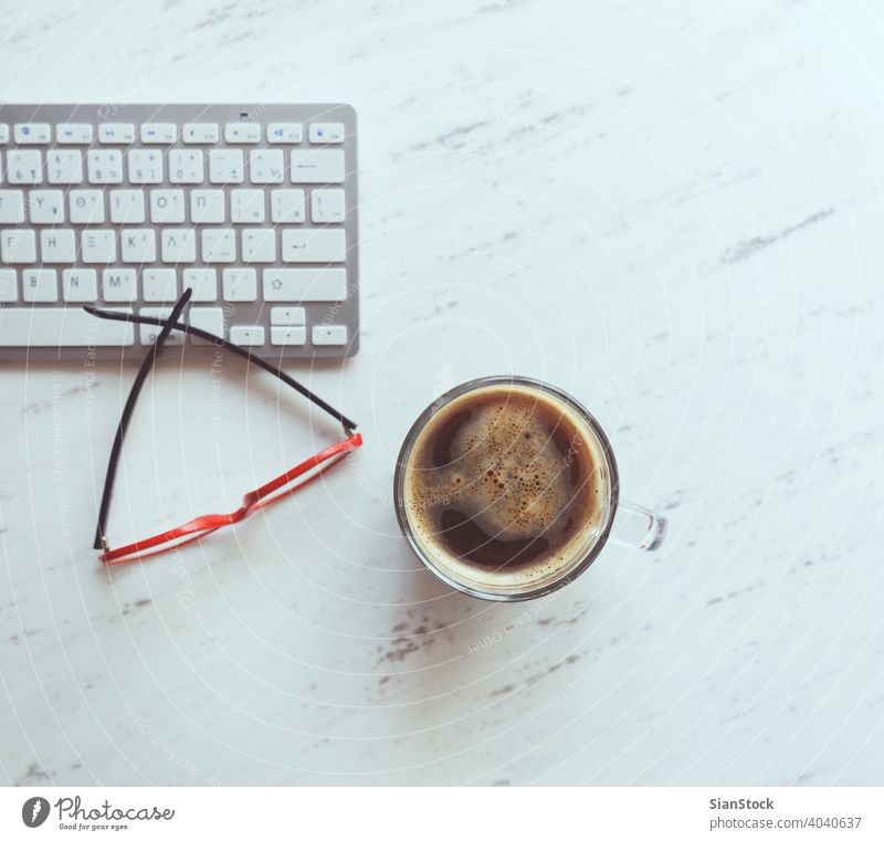 Workplace with glasses, coffee and keyboard. laptop desk view table office computer cup desktop white above work business background space workplace technology