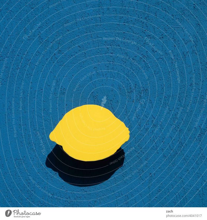 compliant | EU lemon regulation Wall (building) Facade Lemon Yellow Blue Wall (barrier) Fruit Fruity Citrus fruits Sour Fresh Vitamin C Lemon yellow Food