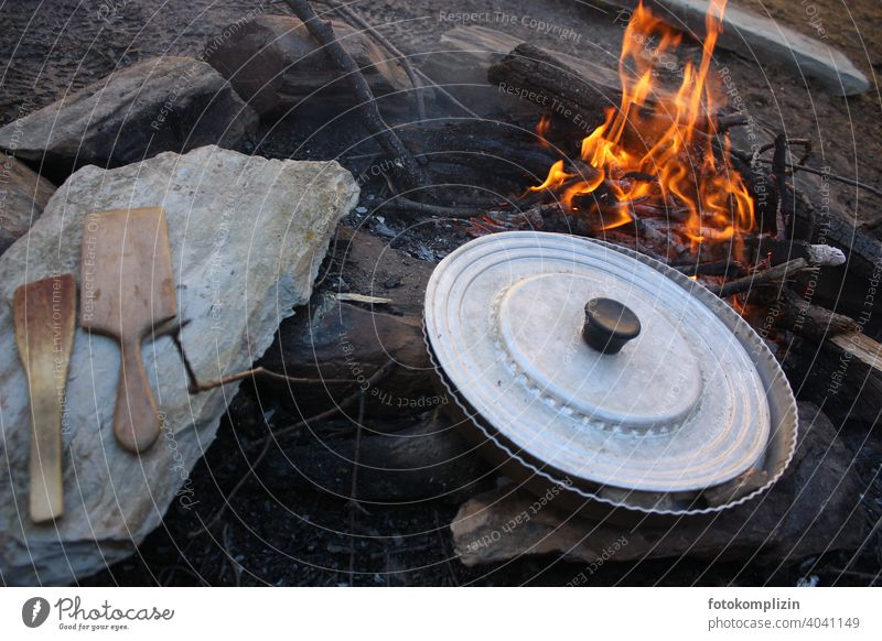 Campfire with pan and cooking utensils campfire boil Fire Fireplace Flame Pan Cooking Wooden spoon Adventure adventurous Wild Quaint Camping Primordial