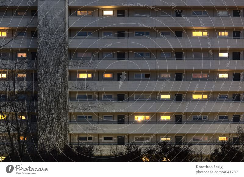 Apartment block with illuminated windows dwell block of flats stay at home Evening Light seclusion Window Facade Town Architecture Balconies Exterior shot