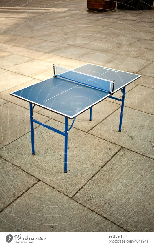 table tennis table Disinterest Going off walkway slab kinderladen Markets Human being Passer-by Places game Playground Sports Table tennis Table tennis table