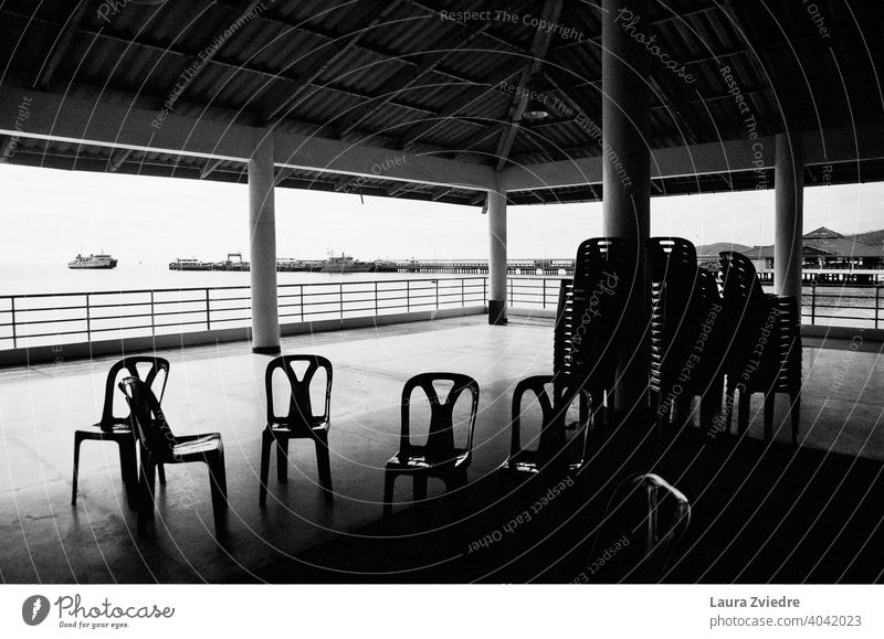 Have a rest before the trip chairs Pile of chairs Chair Seating Sit Furniture Empty Many Loneliness no people Row of seats Roof Under the roof ships