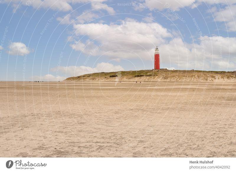 "Sandy beach and lighthouse called ""Eierland"" architecture beacon blue building clouds coast coastline cocksdorp color colorful dunes dutch europe holland"