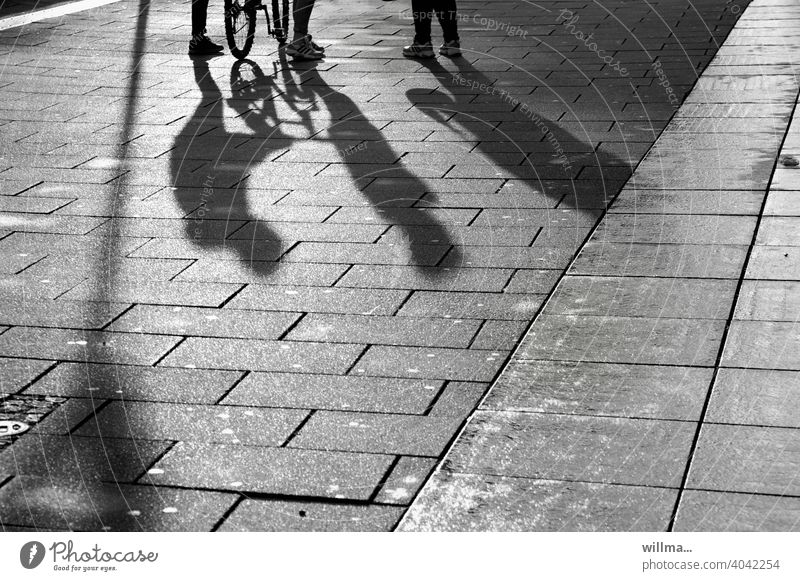 Encounters - when two meet a third Shadow people 3 communication meetings chat Group Pedestrian Places Pedestrian precinct Legs Bicycle maintain entertainment