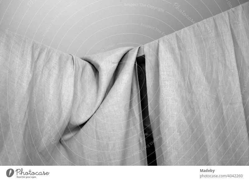 Linen cloth on a line as a curtain in a designer apartment in a farmhouse in Rottenbuch in the district of Weilheim-Schongau in Upper Bavaria, photographed in classic black and white