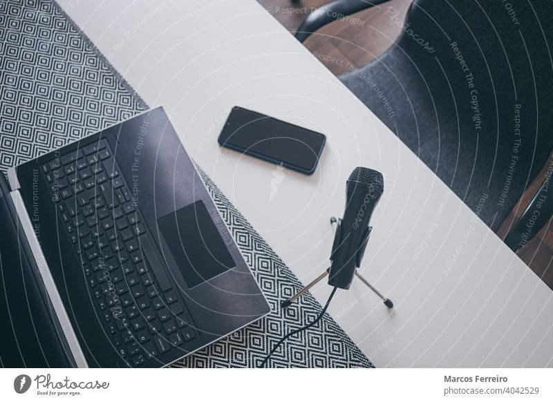 workplace blogger with microphone, laptop and smart phone. Home work. home workspace home worker homework production top view audio businessman accessory media