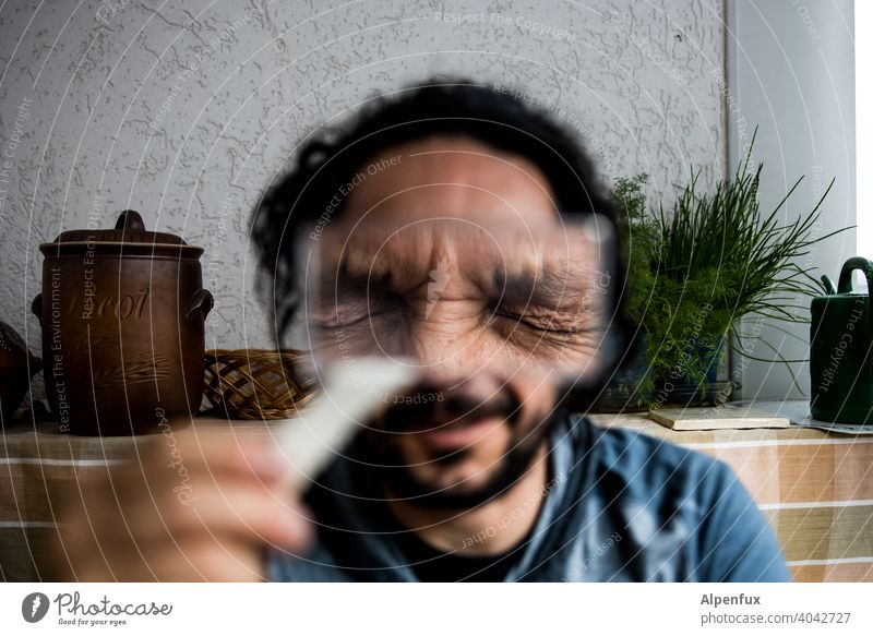 I don't see it Magnifying glass magnifying glass holder Looking away Enlarged Close-up Face Facial expression Interior shot Human being Man Eyes Colour photo
