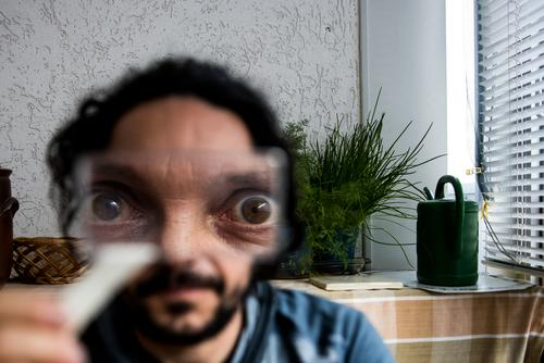 They're watching us! eyes alien Head Face Colour photo Human being portrait Extraterrestrial being Magnifying glass Magnifying effect magnifying glass holder