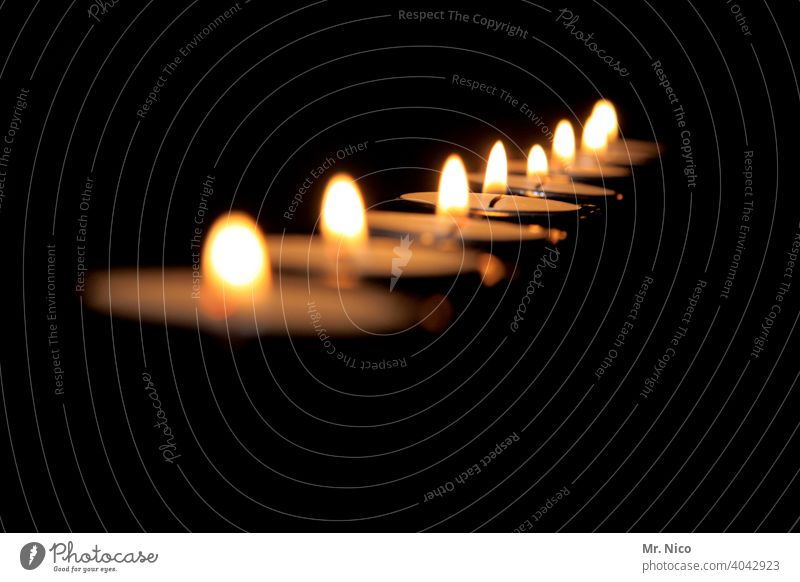 tea lights Flame cauterizing blaze traditionally candles Moody ornamental Decoration Pensive reflectiveness shoulder stand burning candles Cozy