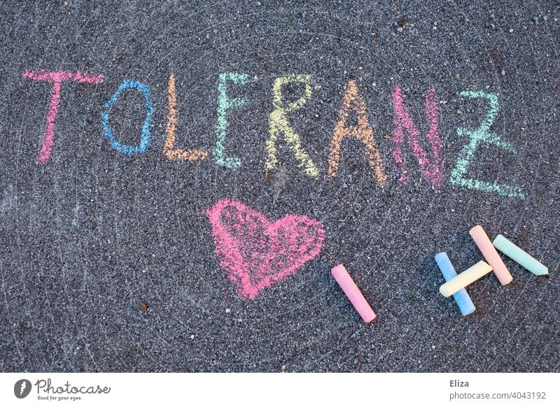 The word tolerance written with colorful sidewalk chalk Tolerant Word authored variegated street-painting chalk Chalk Text Heart LGBTQ at the same time