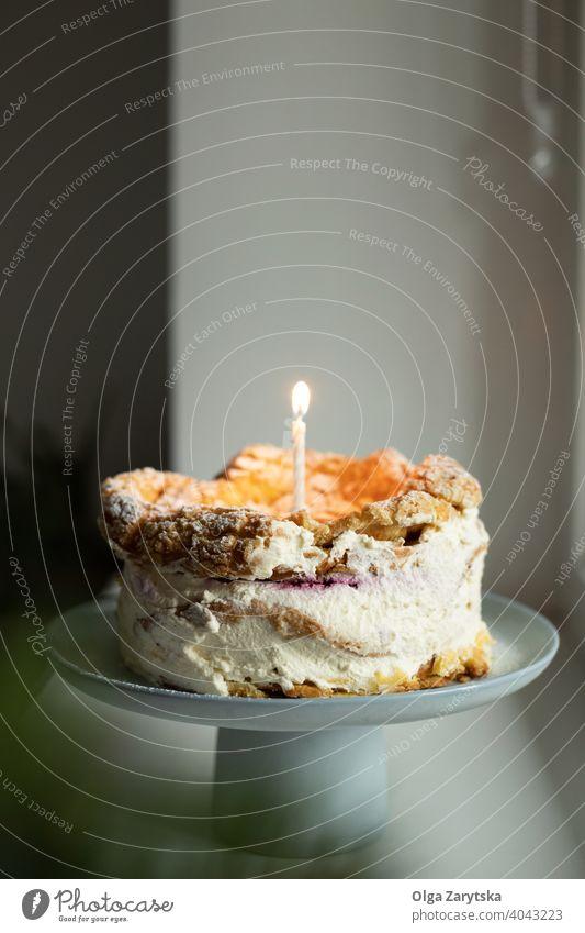Polish Carpathian Mountain Cream Cake with birthdate candle. dessert karpatka cream birthday cake polish stand homemade morning rustic white pastry holiday