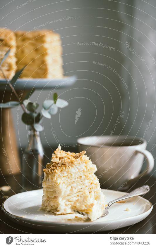 Slice of multilayers cake Napoleon. napoleon homemade dessert tea food custard cream sweet cup stand plate puff sugar table bake vanilla background delicious