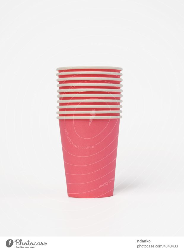 pink paper disposable cups on a white background, concept eco-friendly dishware drink empty fast food hot liquid mug nobody package party portable recycling