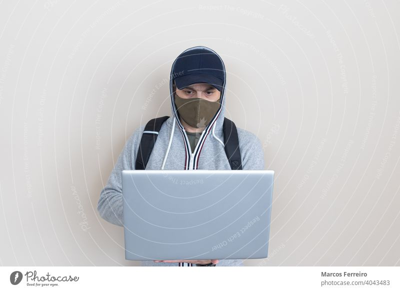 man with laptop in hands and mask technology hygiene virus protection standing business man in mask facemask health care laptop holding in his hands notebook