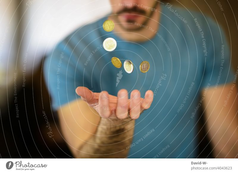 Man catches coins with his hand Money Coin € euro coins Euro Luxury Success finance Thrifty capital austere creatively Avaricious Loose change investment assets
