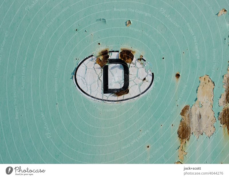 Country code D Germany Rust Oval Crack & Rip & Tear Retro Green Transience Change Made in Germany Detail Neutral Background Ravages of time Weathered Design