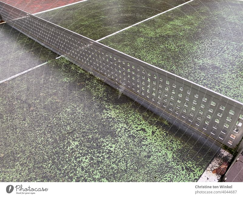 Old worn out outdoor table tennis table Table tennis table Table tennis net worn-out Partition Sports Leisure and hobbies Border demarcation Net Line