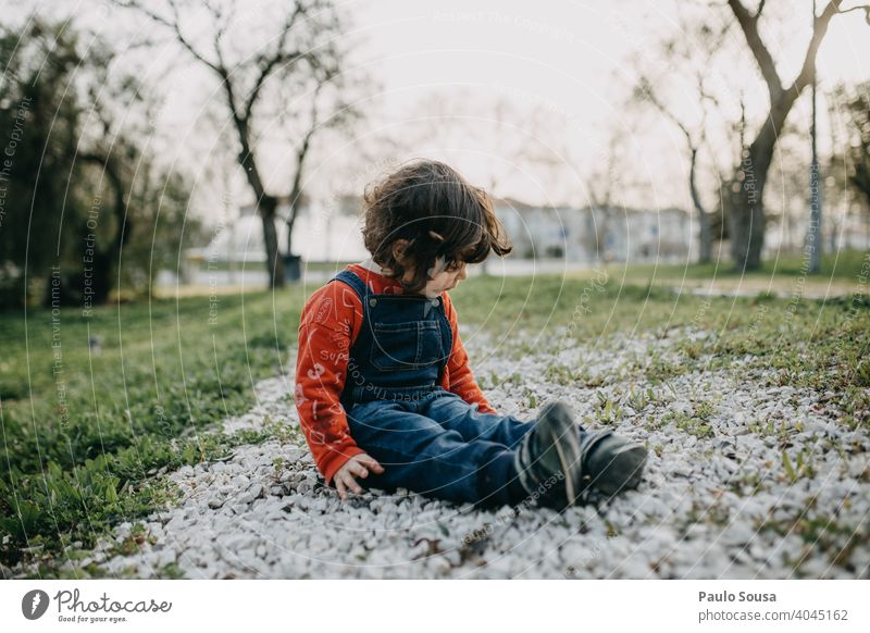 Child playing in the park Caucasian 1 - 3 years Girl Spring Park Lifestyle Infancy Colour photo Exterior shot Toddler Leisure and hobbies Nature Playing