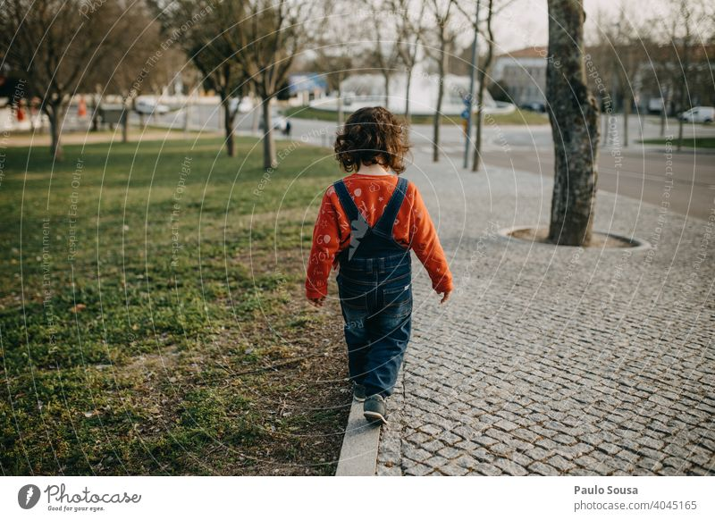 Rear view child walking on the sidewalk Sidewalk Pavement Child Walking 1 - 3 years Playing Day Toddler Exterior shot Human being Colour photo Infancy