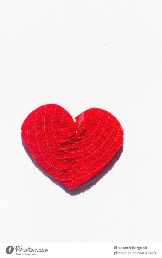 sewn together red heart (made of felt) on white background Lovesickness heartache Heart Divorce Hope Divide pain of separation repair Pain