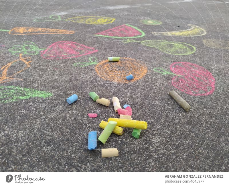 colored chalk on the floor with children's drawings creativity play ground outside activity paint asphalt school artistic kid childhood fun playground joy