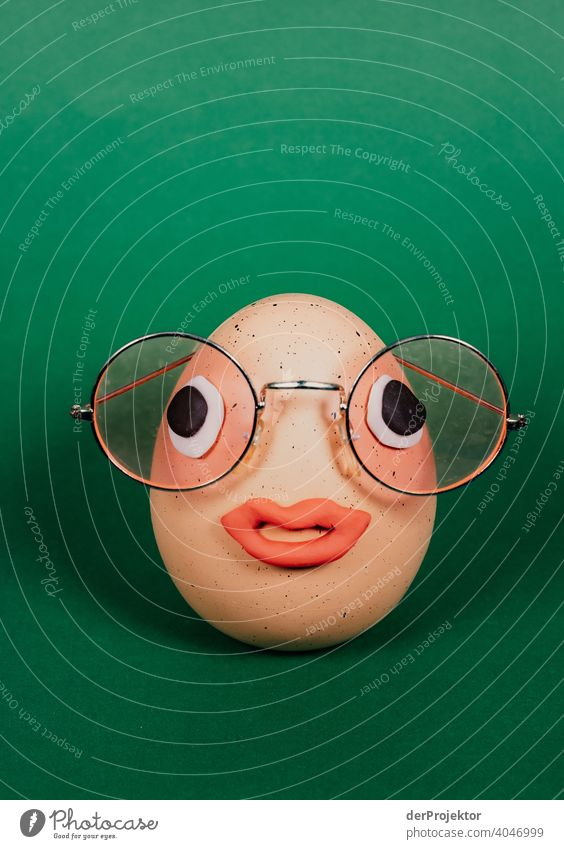 Easter egg with pink glasses and eyes and mouth made of plasticine Easter eggs Easter Monday Easter gift Easter wish Easter weather Egg Decoration