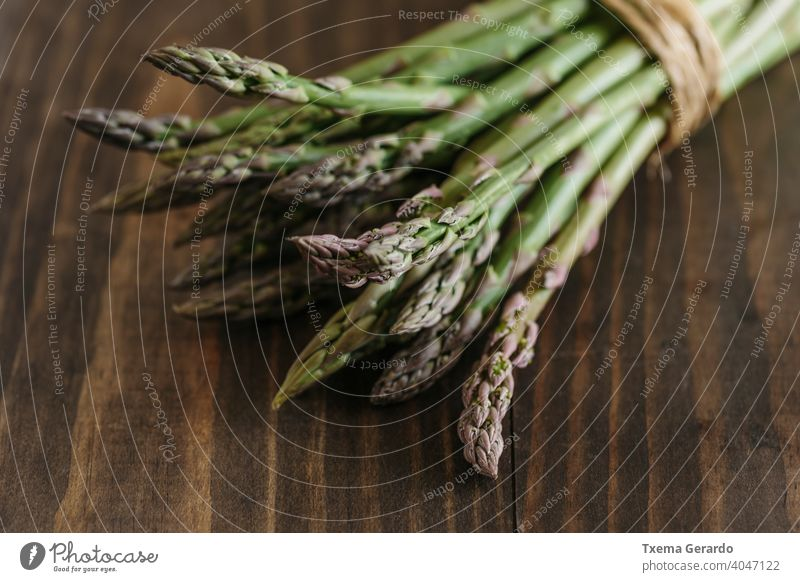 Bunch of raw fresh asparagus on wooden table. Focus on foreground. food green vegetable healthy background diet pepper eating nutrition meal organic fruit