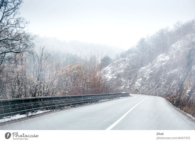Mountain road in Slovakia at winter time mountain mountain road slovakia way nature fog foggy cold freezing snow snowy white landsacpe barrier trees journey