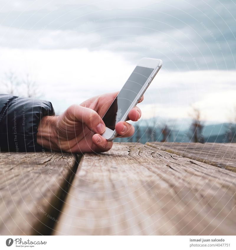 man with a smartphone, mobile addiction person human hand telephone white technology communication business screen cell cellphone display digital call camera