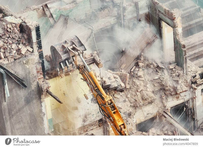 Building demolition in progress, view from above. building destruction industry excavator rubble wall work machinery equipment construction site house