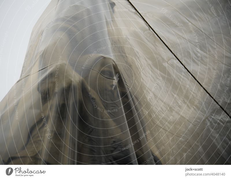 tied up & wrapped Work of art Sculpture Tourist Attraction Budapest Monument Historic Transparent Encased in Subdued colour Shadow plastic tarpaulin Rope Detail
