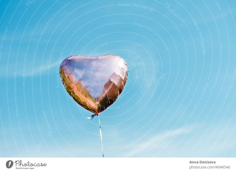 Heart shaped ballon on the sky background balloon heart red blue color love gift romantic birthday white celebration celebrate air abstract summer decoration