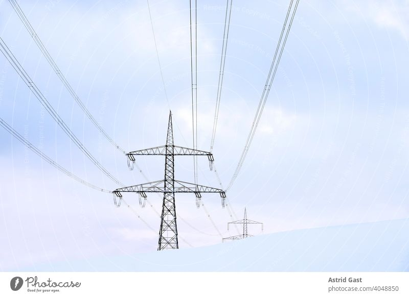 Overhead line pylons in Germany in winter in the snow Electricity pylon Overhead line mast Pole Cable stream power cable power line Power generation Electrics