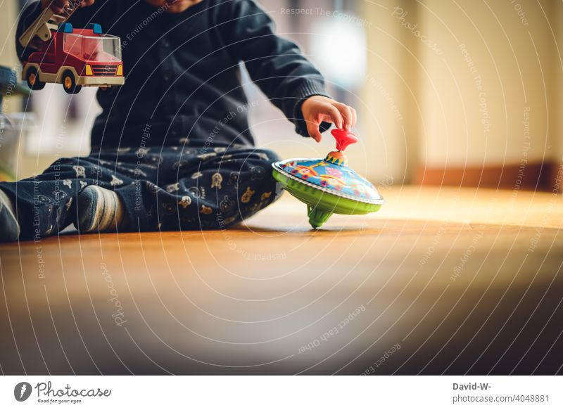 child playing on the floor at home Playing Child fun Toys explore Joy childcare Infancy Cute Happy Children's room Contentment Employment Gyroscope
