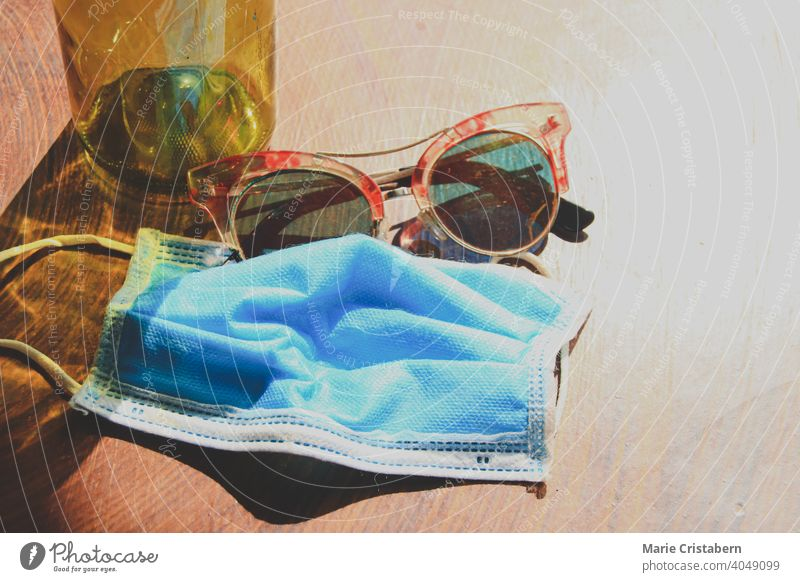 Medical mask and summer sunglasses to show the new normal lifestyle during summer new normal summer summer concept no people medical mask surgical mask covid-19