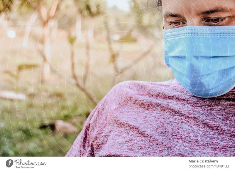 Close up of a man wearing headphones and a medical mask surgical mask close up new normal new normal lifestyle daily life coronavirus covid-19 pandemic epidemic