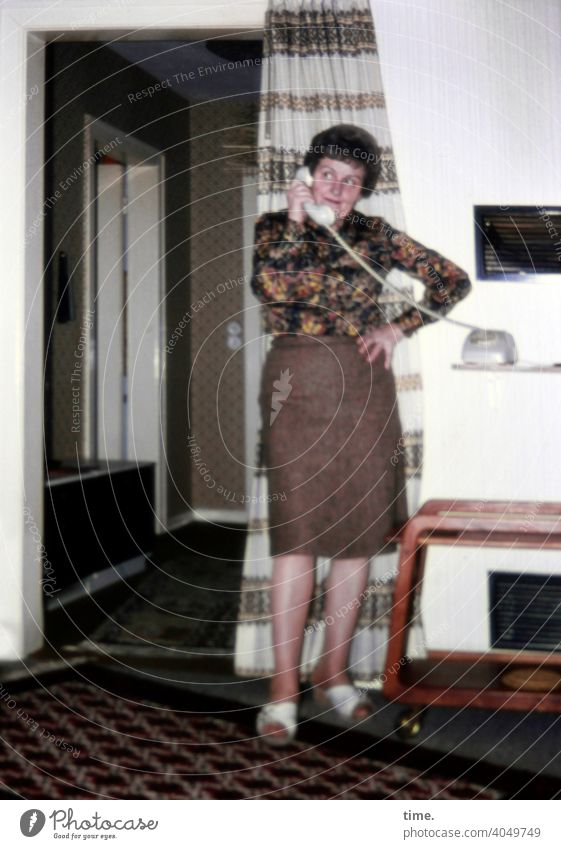 grapevine Woman Telephone make a phone call Flat (apartment) interior decoration Hallway Drape Living or residing Skirt Blouse Dark-haired inquisitive engaged