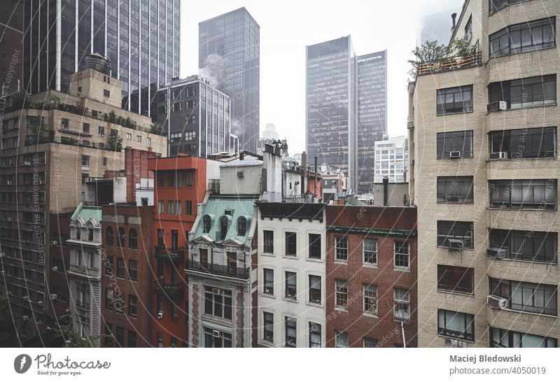 Foggy day in New York City, color toned picture, USA. city building Manhattan house fog rain retro midtown apartment NYC urban new york weather office