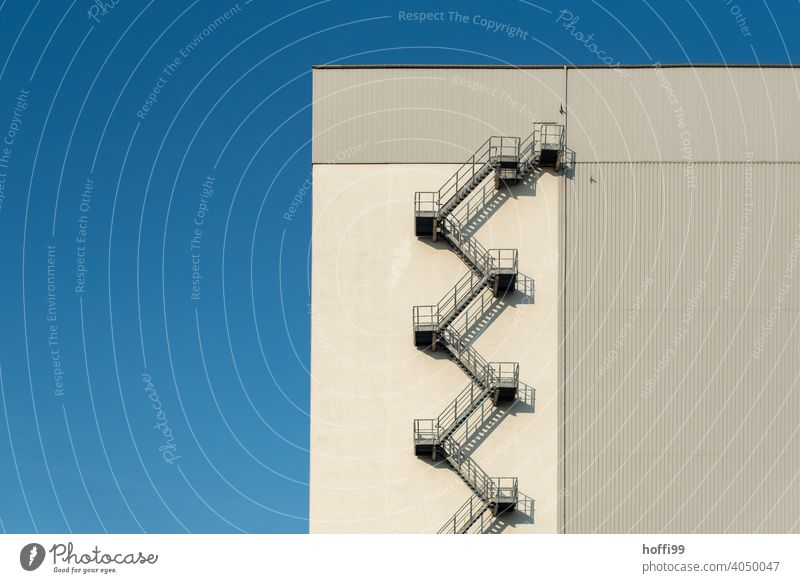 Outside staircase in the harbour Stairs Emergency exit Winding staircase emergency staircase Factory Escape route Structures and shapes Storage Industrial