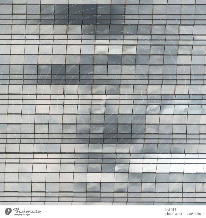abstract glass facade in which clouds and light are reflected Building architectural photography Urbanization Architecture Glas facade Glass Window Facade