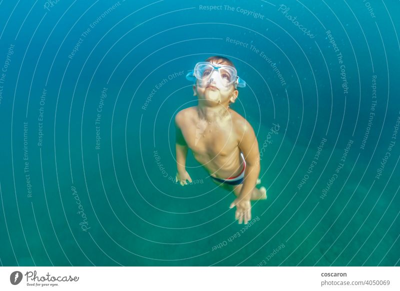 Little kid snorkeling on the ocean active active boy aqua beach beach vacation child childhood clear clear ocean coral reef deep down dive diving enjoy nature
