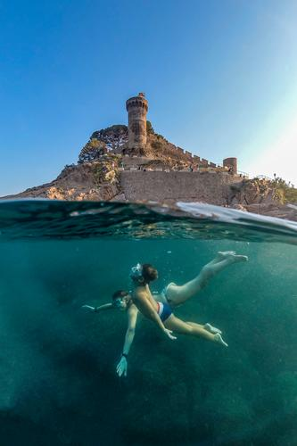Mother and son snorkeling with a castle in the background active apnea beach boy caribbean child childhood cute dive diver enjoying enjoyment exploration fun