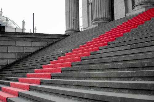 red carpet for the staircase Culture Red carpet Stairs Reliability Honor Success Lanes & trails Pecking order Structures and shapes Neutral Background