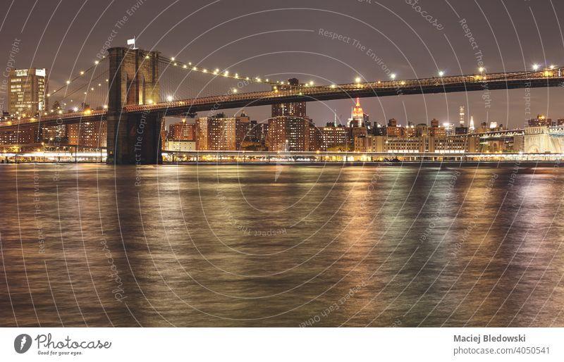 Brooklyn Bridge at night, USA. bridge New York NYC Manhattan skyline city travel illuminated river water urban new york architecture outdoors Big Apple