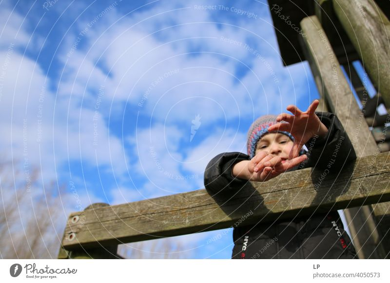 child reaching hands downward Upper body Dependability Exterior shot Multicoloured Help Safety (feeling of) Protection Trust Brave Self-confident Bravery