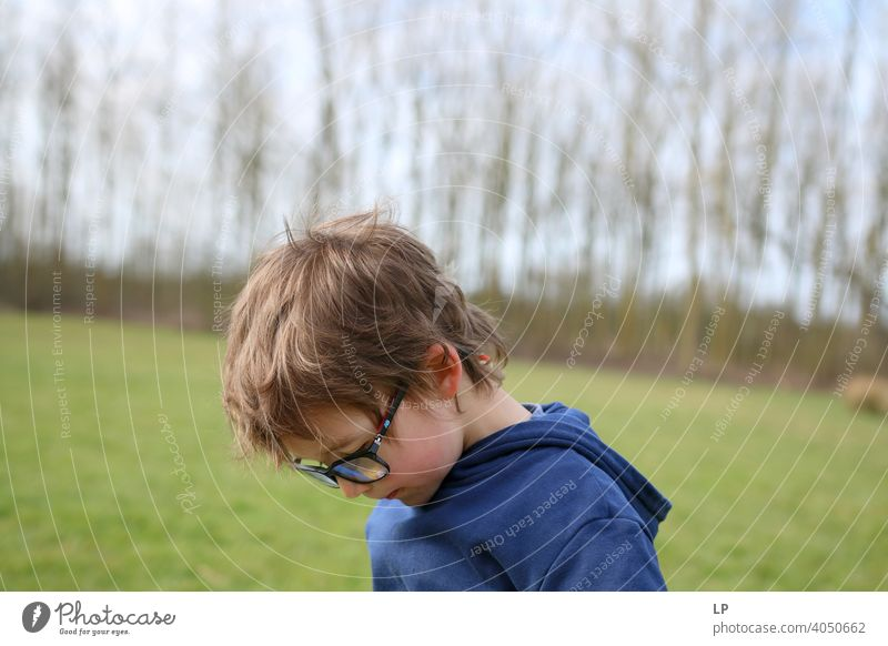 child wearing glasses looking down safety epidemic quarantine listen music family time Technology Questioning Relaxation Resting discovering detect Parenting