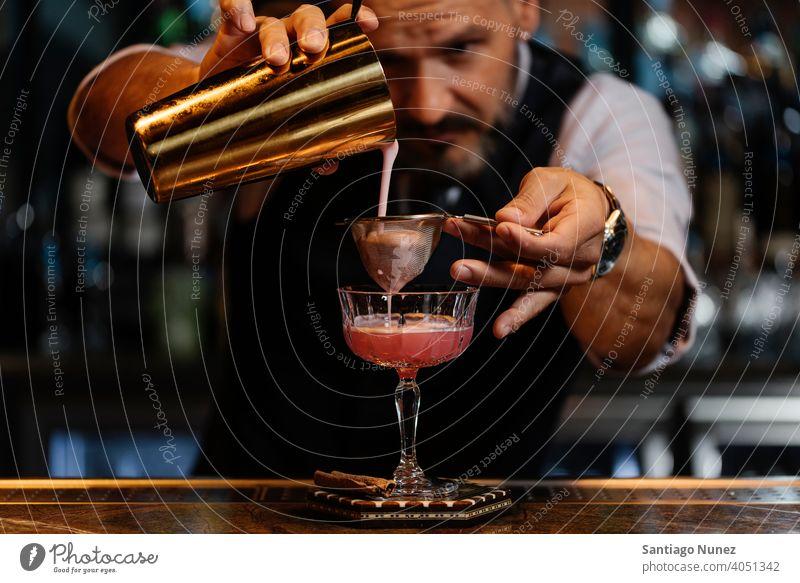 Portrait of expert barman. bartender nightclub pub beverage liquor alcohol drink party restaurant cocktail professional nightlife preparation shaker counter