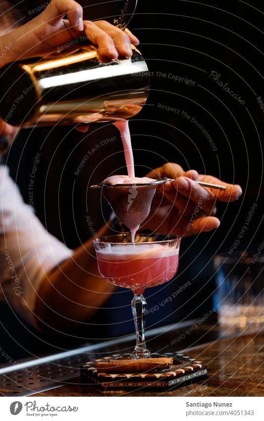 Barman is making cocktail at night club. bartender nightclub pub beverage liquor barman alcohol drink party restaurant professional nightlife preparation shaker